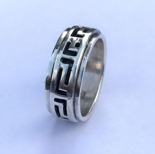 Silver ring with turning middle panel